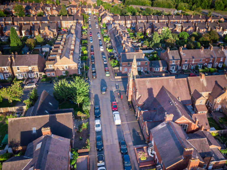 View of streets and houses British residential area from the air.