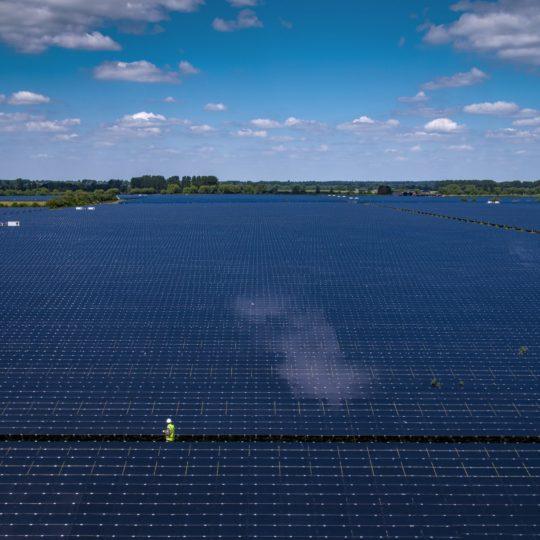 Man among huge solar power plant