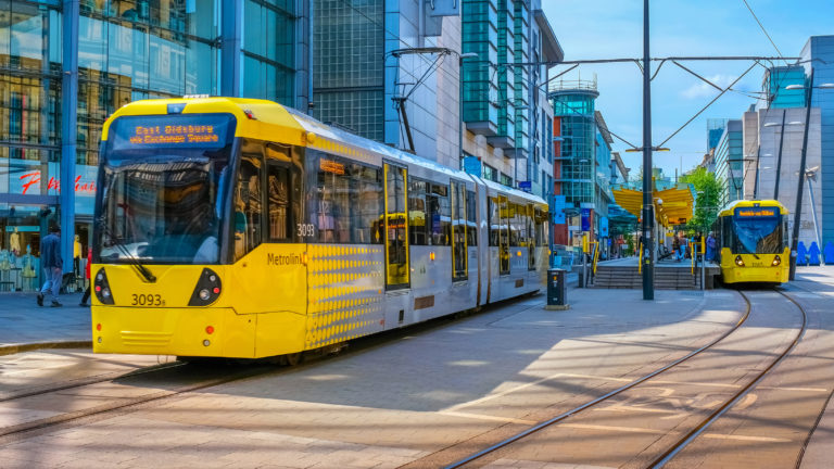 A Metrolink tram on the streets of Manchester England