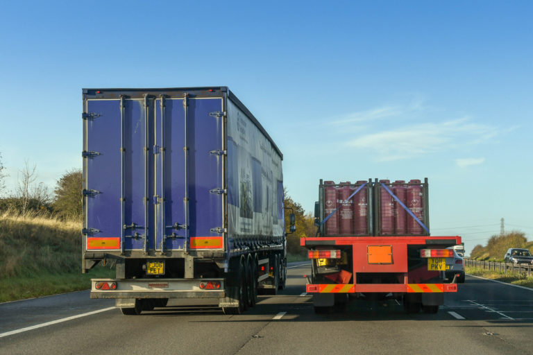 Articulated lorry overtaking another lorry on a motorway