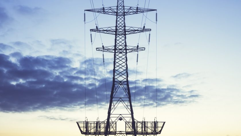 Electricity pylon against the evening sky