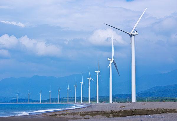 windmills against a blue sky